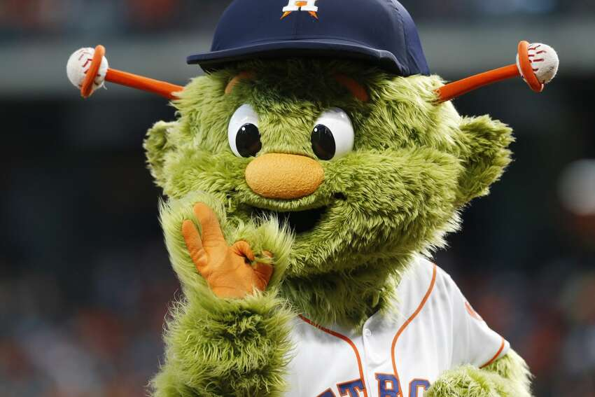 Houston Astros mascot Orbit encourages a ceremonial first pitch participant before the Astros host the Baltimore Orioles at Minute Maid Park in Houston on Saturday, June 8, 2019. Baltimore Orioles won the game 4-1.