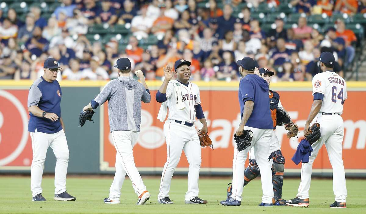 Houston Astros starting pitcher Framber Valdez (59) is greeted by other pitchers before throwing against Baltimore Orioles at Minute Maid Park in Houston on Saturday, June 8, 2019. Baltimore Orioles won the game 4-1.