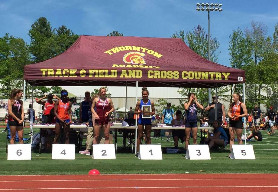 Danbury's Alanna Smith, center, won the 400 at the New England championships on Saturday. Photo: Contributed Photo
