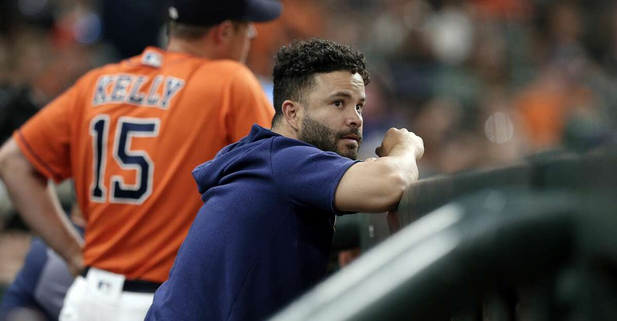 Houston Astros Jose Altuve watches the game from the dugout during a baseball game against the Baltimore Orioles Friday, June 7, 2019, in Houston. (AP Photo/Michael Wyke)