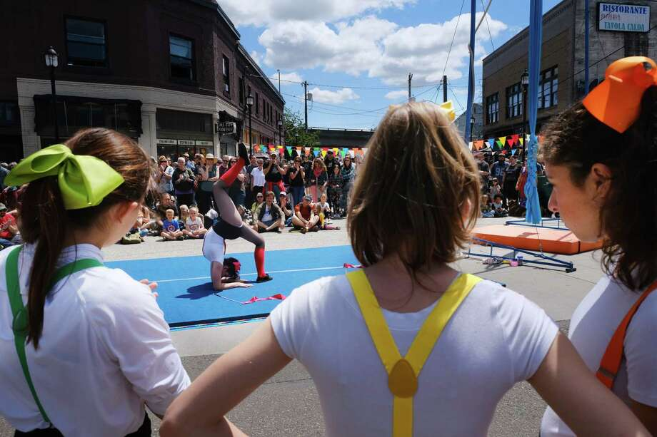 The School of Acrobatics and New Circus Arts (SANCA) students perform during the annual Georgetown Carnival street fair, which featured live music, power tool races, performances from SANCA gymnasts and circus students, art shows and food, Saturday, June 8, 2019. Photo: Genna Martin, SEATTLEPI / GENNA MARTIN