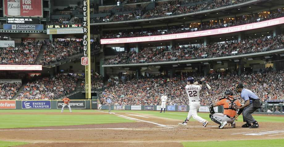 Houston Astros right fielder Josh Reddick (22) connects for his 1000 career hit in the second inning against Baltimore Orioles at Minute Maid Park in Houston on Saturday, June 8, 2019. Astros lead the three-game series 1-0. Photo: Elizabeth Conley/Staff Photographer