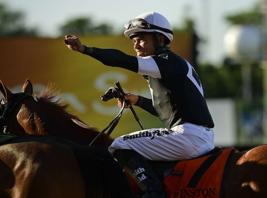 Jockey Joel Rosario reacts after winning the 151st running of the Belmont Stakes. Photo: Steven Ryan / Associated Press