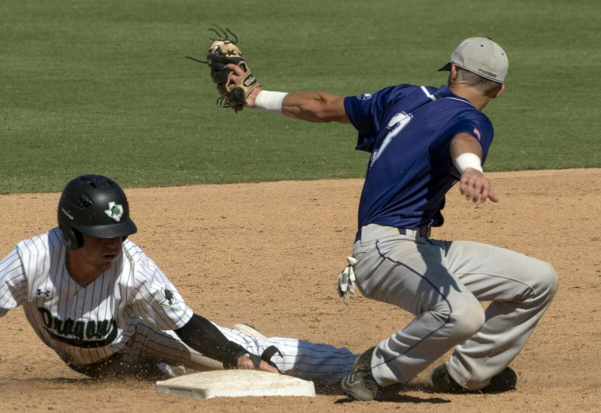 Fort Bend Ridge Point Justin Vossos, (7), misses the tag on Southlake Carrol Justin Grech, (9), after he stole second base during the second inning of the UIL Class 6A state championship held at the Dell Diamond, Saturday, June 8, 2019, in Round Rock, Texas. Fort Bend Ridge Point was defeated by Southlake Carroll 17-0. (Rodolfo Gonzalez for Houston Chronicle)