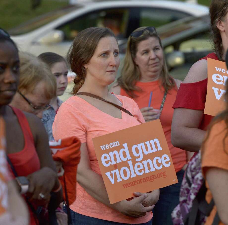 Claire DeJesus, of New Milford, attended the Litchfield Moms Demand Action for Gun Sense vigil-remembrance on the New Milford green Saturday evening. June 8, 2019. The event recognizes National Gun Violence Awareness Day and Wear Orange Weekend. Photo: H John Voorhees III / Hearst Connecticut Media / The News-Times