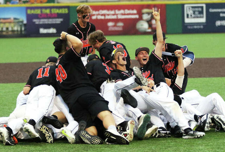 The Edwardsville Tigers celebrate their Class 4A baseball state championship Saturday night in Joliet after beating St. Charles North 3-2 in eight innings. Photo: Greg Shashack / The Telegraph
