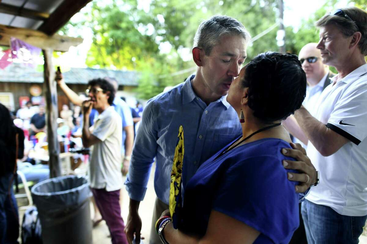 Incumbent San Antonio Mayor Ron Nirenberg kisses his wife, Erika Prosper, during his runoff election night watch party at The Friendly Spot on Saturday, June 8, 2019.