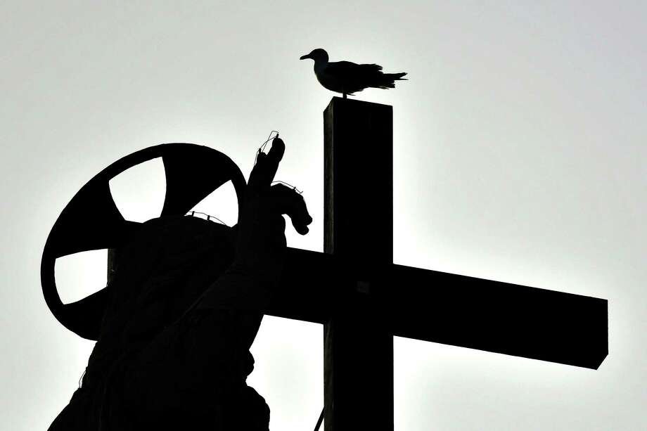 A seagull stand on the cross on the Basilica dome as the Pope Francis celebrates the Pentecost mass-vigil on June 8, 2019 In Saint Peter's square at the Vatican. (Photo by Alberto PIZZOLI / AFP)ALBERTO PIZZOLI/AFP/Getty Images Photo: ALBERTO PIZZOLI / AFP/Getty Images / AFP or licensors