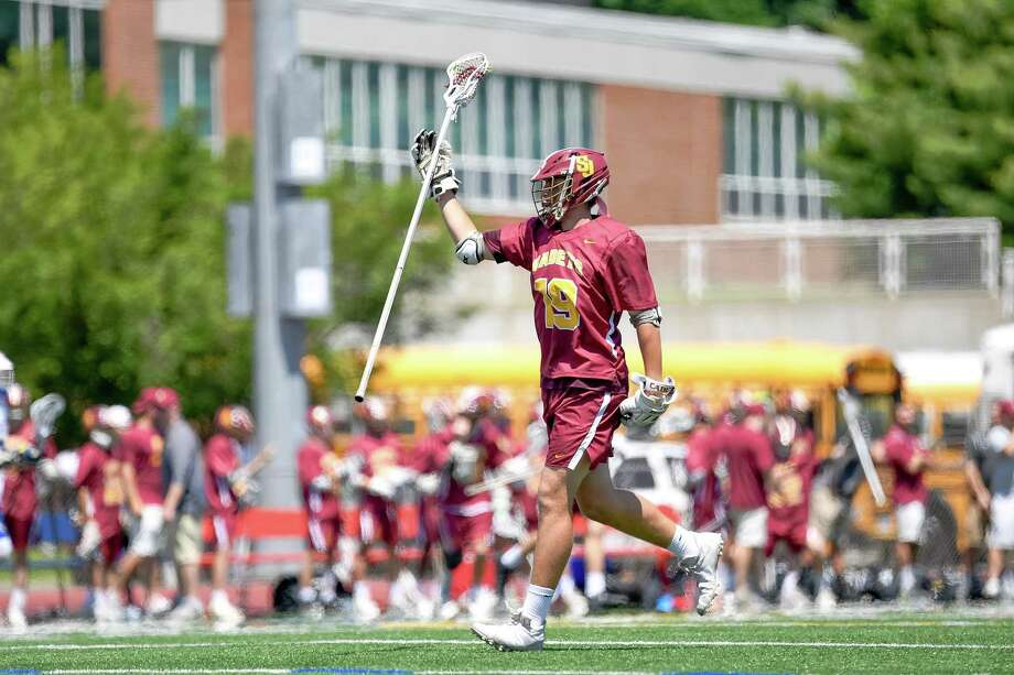 St. Joseph sophomore Owen DaSilva celebrates during Saturday's Class S boys lacrosse state championship game at McMahon High School in Norwalk. Photo: David G. Whitham / For Hearst Connecticut Media / DGWPhotography