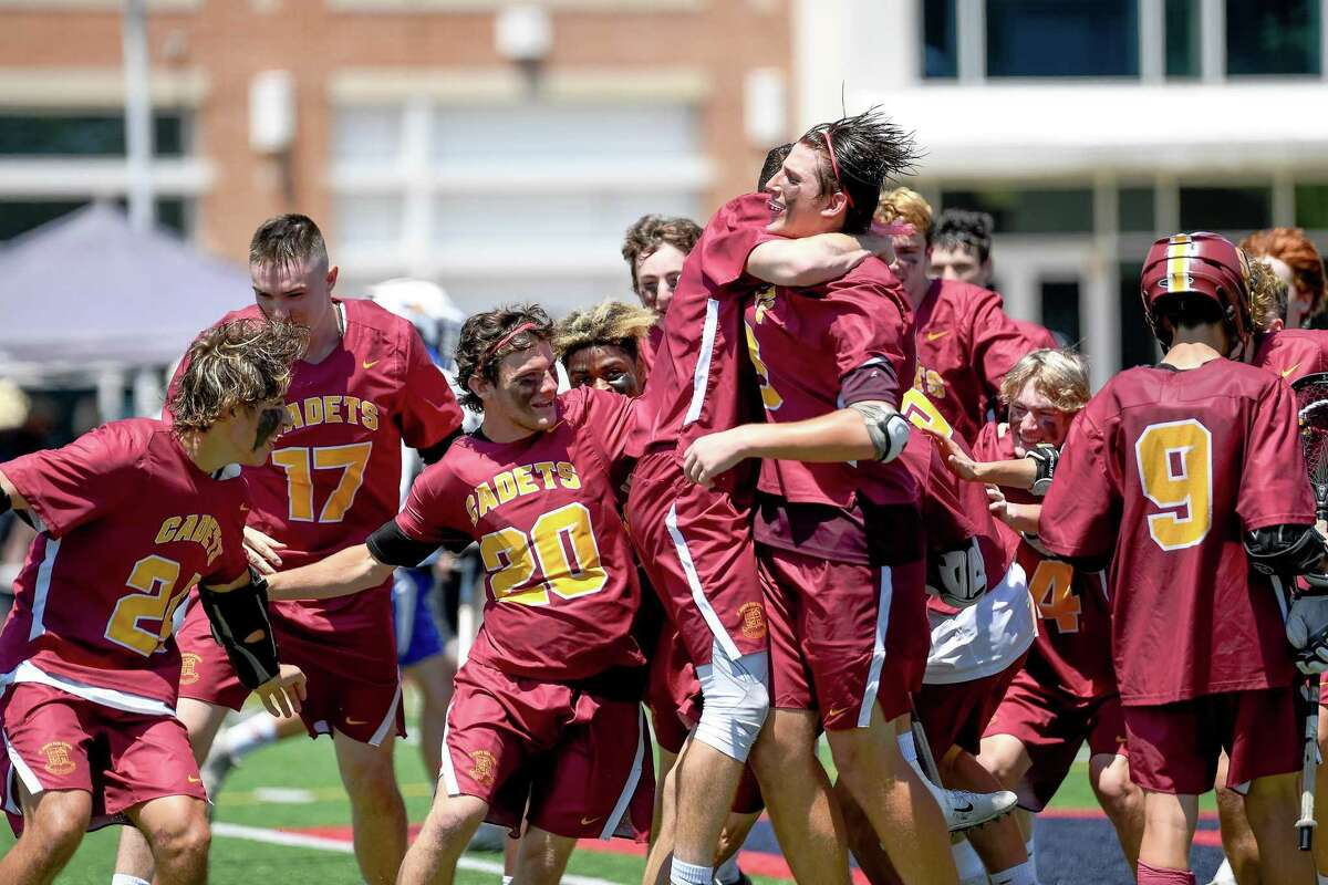 Members of the St. Joseph boys lacrosse team celebrate their 9-3 victory over Bacon Academy Saturday in the CIAC Class S state championship game.