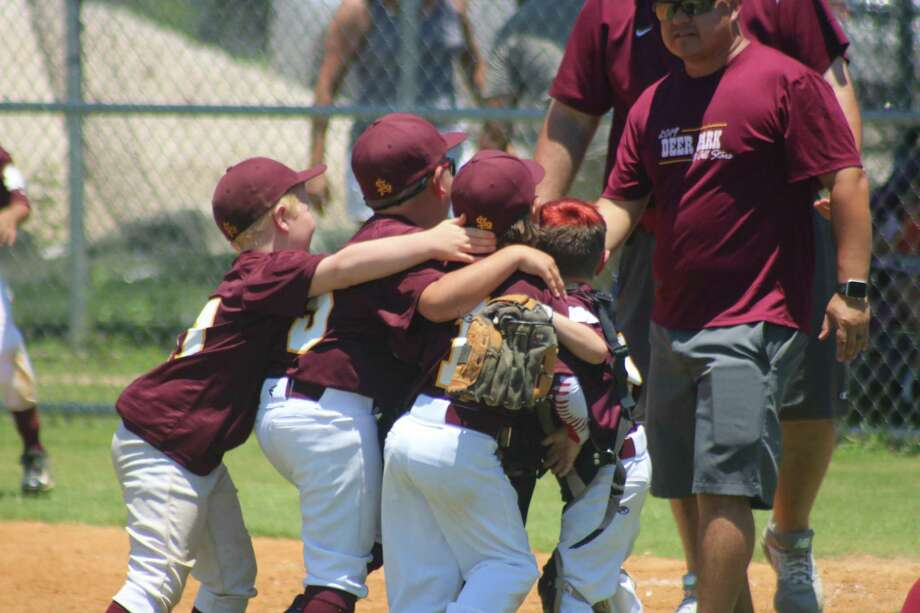 Somewhere in that mob of appreciative Deer Park Pinto All-Stars is Carson Almaguer, who caught a line drive that ended a Katy uprising in its final at-bat. Photo: Robert Avery