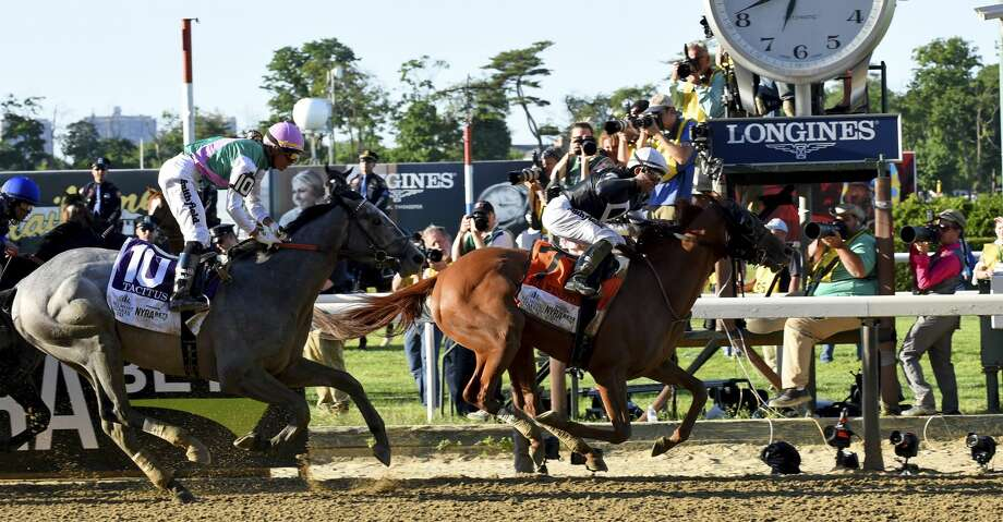 IMAGE DISTRIBUTED FOR LONGINES - Sir Winston, ridden by Joel Rosario, wins the 151st running of the Belmont Stakes, Saturday, June 8, 2019, at Belmont Park in Elmont, NY. Longines, the Swiss watchmaker known for its elegant timepieces, is the Official Timekeeper and Watch of the 151st running of the Belmont Stakes. (Diane Bondareff/AP Images for Longines) Photo: Diane Bondareff/Associated Press