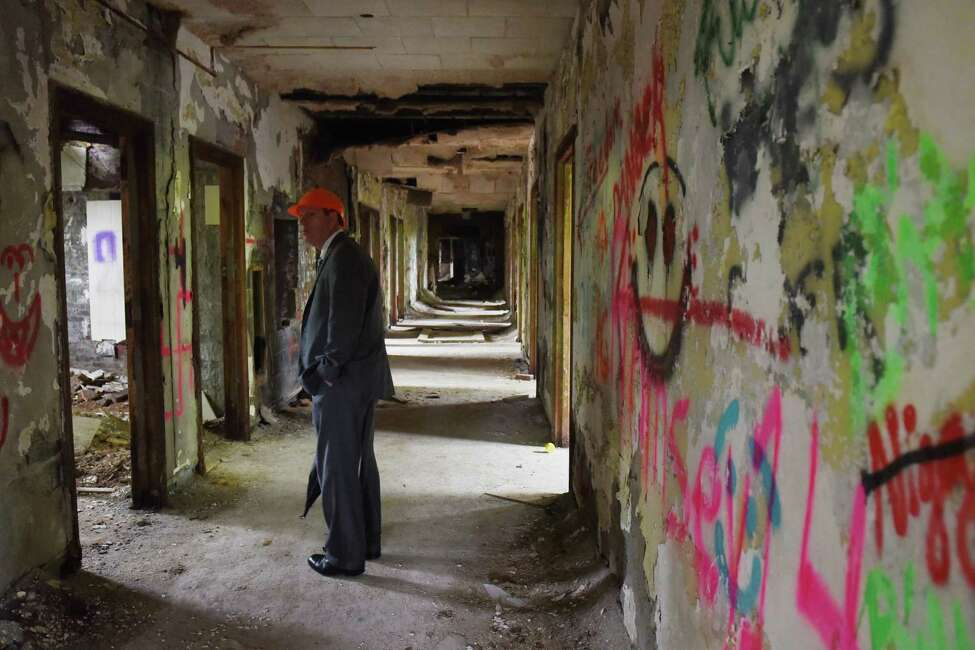 Saratoga County Attorney Stephen Dorsey walks down the hallway inside of the Homestead Asylum on Thursday, May 23, 2019 in Middle Grove, NY. (Phoebe Sheehan/Times Union)
