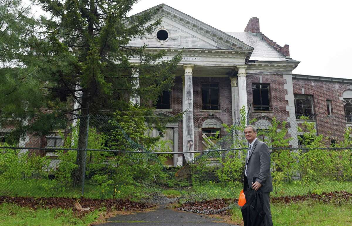 Saratoga County Attorney Stephen Dorsey stands for a portrait in front of the Homestead Asylum on Thursday, May 23, 2019 in Middle Grove, NY. (Phoebe Sheehan/Times Union)