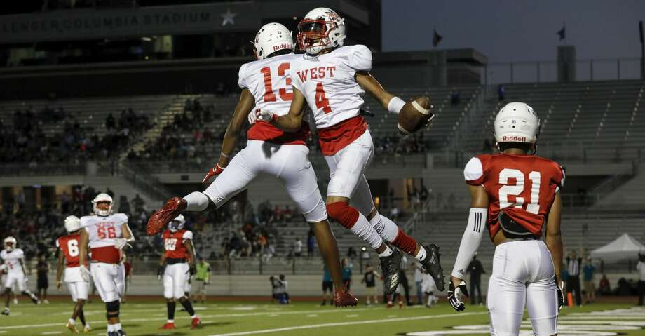 Shadeed Ahmed #4 celebrates with De'Rondre Moore #13 after a third quarter touchdown reception during the 2019 Bayou Bowl at Challenger Columbia Stadium in Webster, TX on Saturday, June 8, 2019. Photo: Tim Warner/Contributor