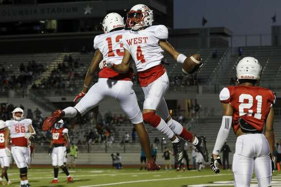 Shadeed Ahmed #4 celebrates with De'Rondre Moore #13 after a third quarter touchdown reception during the 2019 Bayou Bowl at Challenger Columbia Stadium in Webster, TX on Saturday, June 8, 2019.