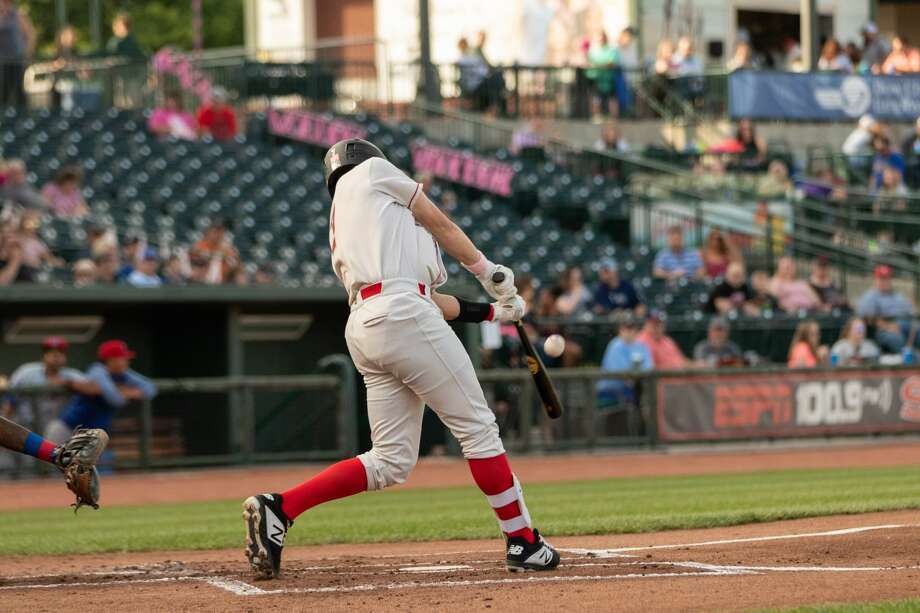 Great Lakes Loons' Hunter Feduccia hits a pitch during Saturday's win over the South Bend Cubs at Dow Diamond. Photo: Alex Seder/Great Lakes Loons