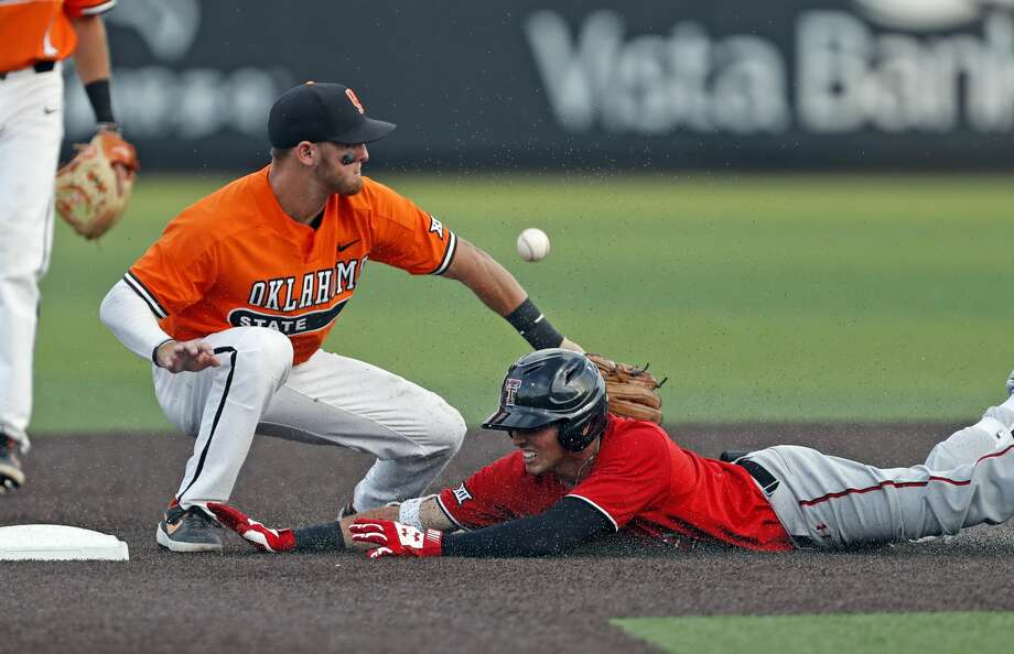 Texas Tech's Gabe Holt slides into second base past Oklahoma State's Andrew Navigato during the ninth inning in Game 2 of an NCAA college baseball tournament super regional Saturday, June 8, 2019, in Lubbock, Texas. (AP Photo/Brad Tollefson) Photo: Brad Tollefson/Associated Press
