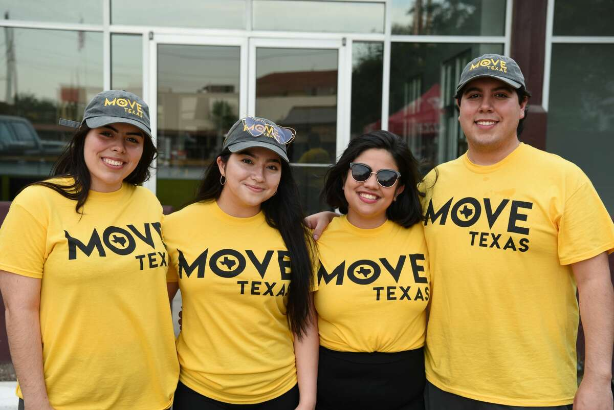 Krystel Castillo, Cecy Jimenez, Victoria Sandoval and Carlos Cardona pose for a photo during the Rock and Glow Ride at Cultura Beer Garden.