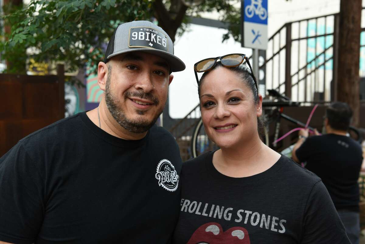 Rene and Becky Gutierrez pose for a photo during the Rock and Glow Ride at Cultura Beer Garden.