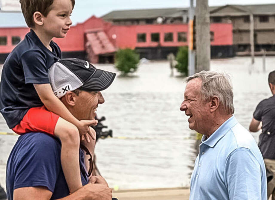 U.S. Sen. Dick Durbin meets a boy and his father, who were checking out Alton's historic flooding Saturday morning. Photo: Nathan Woodside | The Telegraph
