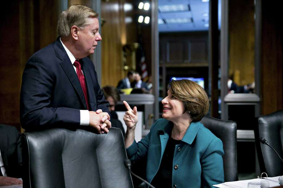 Sen. Amy Klobuchar, D-Minn., talks to Sen. Lindsey Graham, R-S.C., during a hearing with Attorney General William Barr on May 1, 2019. Photo: Bloomberg Photo By Andrew Harrer. / © 2019 Bloomberg Finance LP