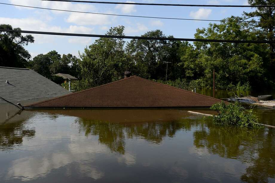 A flooded house in the north end of Beaumont on Thursday.  Photo taken Thursday 8/31/17 Ryan Pelham/The Enterprise Photo: Ryan Pelham / Ryan Pelham/The Enterprise / ©2017 The Beaumont Enterprise/Ryan Pelham