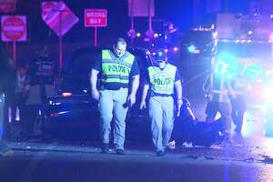 An overnight wreck left one woman dead, two Castle Hills Police officers in serious condition and two other men in critical condition after a pickup truck crashed into an accident scene on the North Side Sunday morning, June 9, 2019.