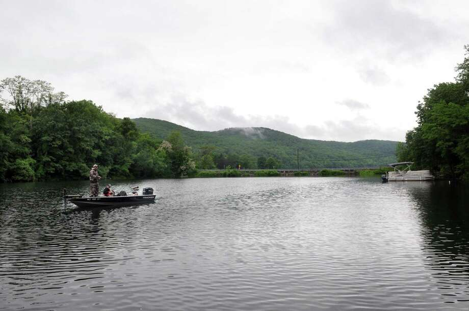 Two men fish off their boat in Squantz Cove in New Fairfield, Conn. Thursday, June 5, 2014. Photo: Carol Kaliff / Carol Kaliff / The News-Times