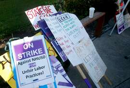 Picket signs are organized at James Logan High School in Union City, Calif. on Tuesday, June 4, 2019. A strike by teachers from the New Haven Unified School District is in its third week.