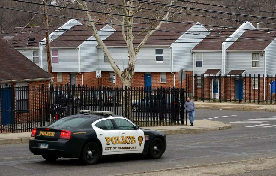 A Bridgeport police cruiser drives along Reservoir Avenue in front of Trumbull Gardens housing complex in Bridgeport, Conn., on Wednesday Mar. 25, 2015. Photo: Christian Abraham / Christian Abraham / Connecticut Post