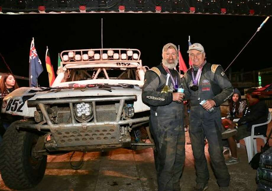 Spencer Morgan, left, and Gary Leyendecker are pictured with their vehicle after winning in Class 8 at the Baja 500 on June 2. Photo: Courtesy Photo