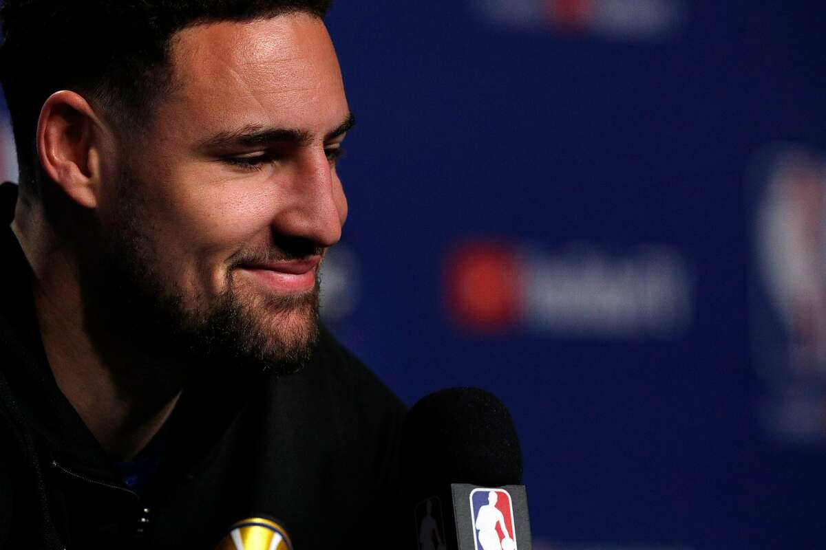 Klay Thompson smiles he listens to a reporters question during a media availability session as the Golden State Warriors and Toronto Raptors practiced before Game 5 of the 2019 NBA Finals at Scotiabank Arena in Toronto, Ontario, Canada, on Sunday, June 9, 2019. The Raptors lead the series 3-1