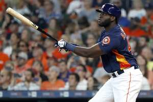 Houston Astros designated hitter Yordan Alvarez (44) hits his first home run in his second at bat during the fourth inning of an MLB game at Minute Maid Park, Sunday, June 9, 2019, in Houston.