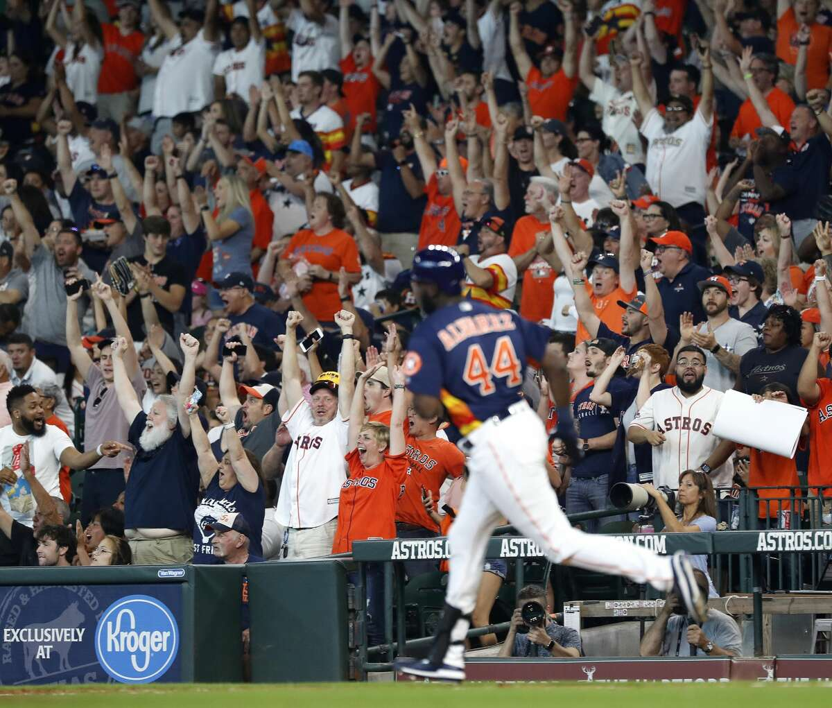 Fans cheer after Houston Astros designated hitter Yordan Alvarez (44) hits his first home run in his second at bat during the fourth inning of an MLB game at Minute Maid Park, Sunday, June 9, 2019, in Houston.