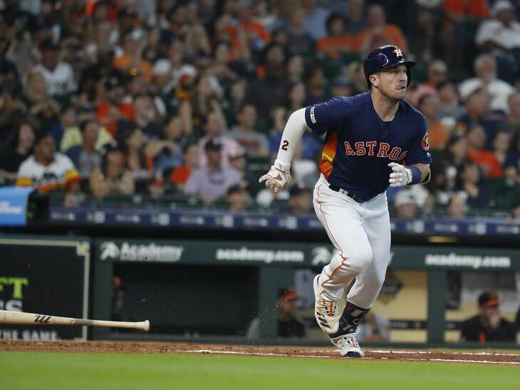 Houston Astros third baseman Alex Bregman (2) flies out during the first inning of an MLB game at Minute Maid Park, Sunday, June 9, 2019, in Houston.