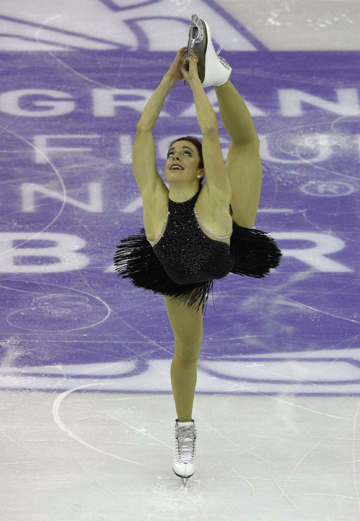 US Ashley Wagner competes during Ladies Short program at the ISU Grand Prix of Figure Skating Final 2015 in Barcelona on December 11, 2015. AFP PHOTO / LLUIS GENELLUIS GENE/AFP/Getty Images