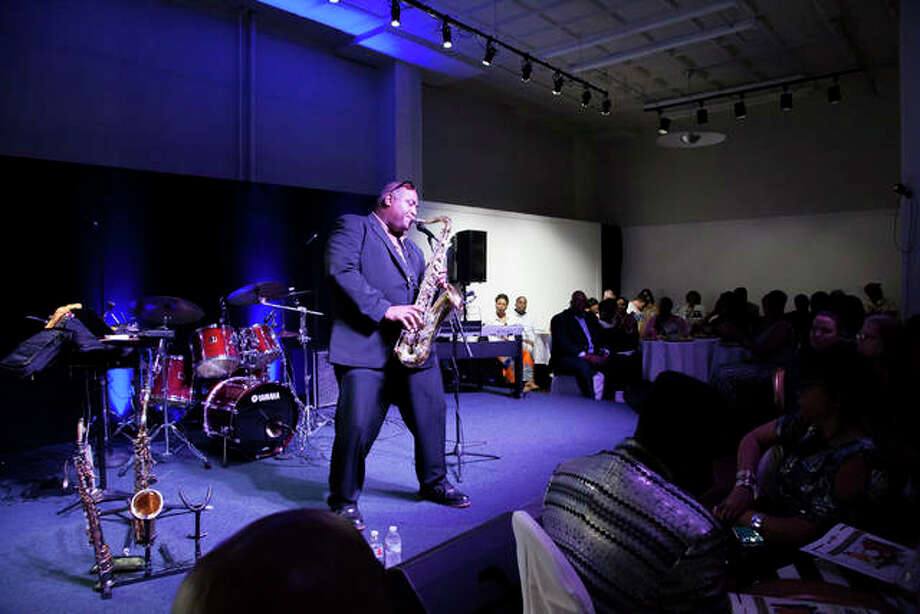 Michael Anthony Fitzgerald played three different types of saxophones to a sold out crowd during the 14th Annual Miles Davis Jazz Festival Saturday at Jacoby Arts Center. The festival pays tribute to the Alton-born jazz icon Miles Davis Photo: By Jeanie Stephens