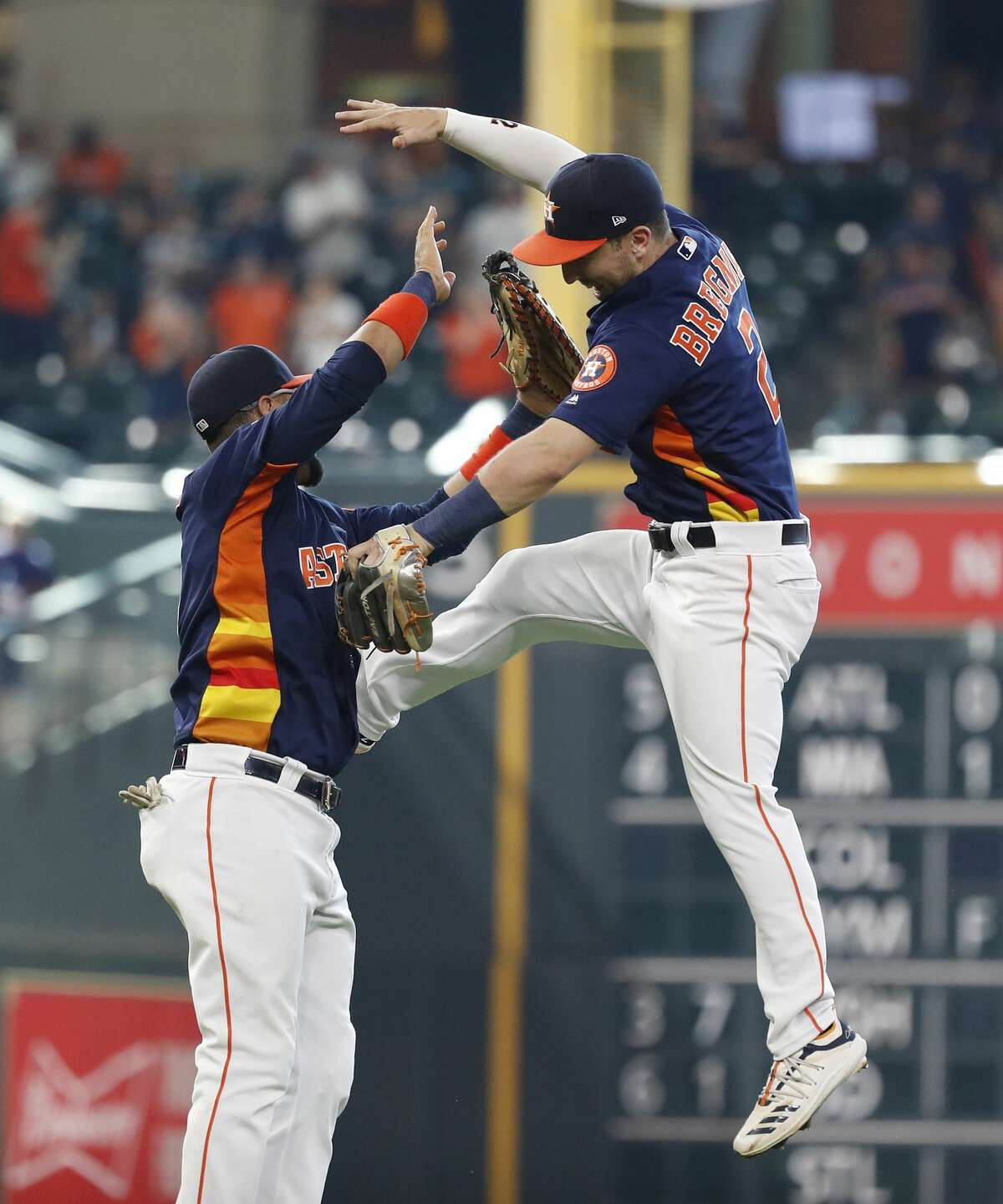 Houston Astros third baseman Alex Bregman (2) and Yuli Gurriel (10) celebrate the Astros 4-0 win after an MLB game at Minute Maid Park, Sunday, June 9, 2019, in Houston.