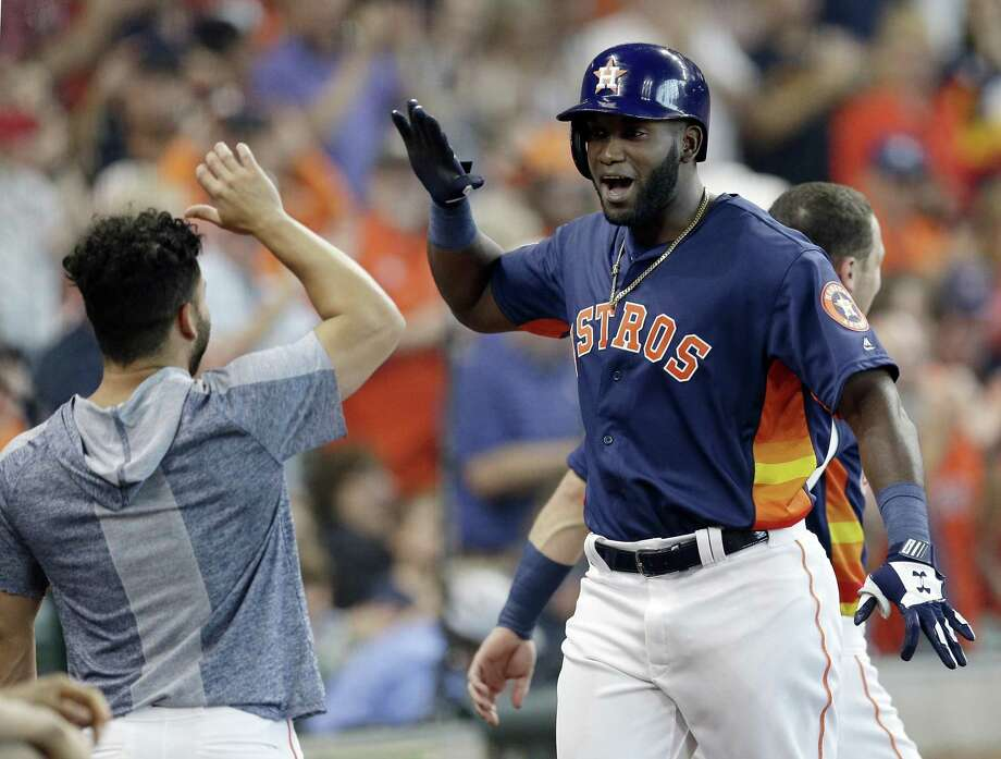 Houston Astros designated hitter Yordan Alvarez, right, gets a high-five from Jose Altuve after hitting a two-run home run during the fourth inning of a baseball game Sunday, June 9, 2019, in Houston. Photo: Michael Wyke, FRE / Associated Press / Copyright 2019 The Associated Press. All rights reserved.