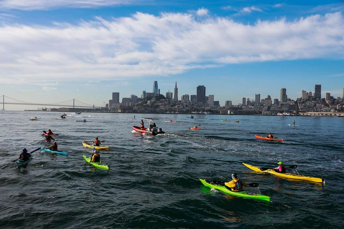 Kayaks get themselves in position to help guide swimmers to the shore ahead of the 39th annual Escape from Alcatraz Triathalon in San Francisco, California, on Sunday, June 9, 2019. Over 2,000 athletes swam the 1.5 miles to shore followed by an 18-mile bike ride and an 8-mile run through San Francisco. The race is considered one of the oldest and most difficult triathlons with many elite participants.
