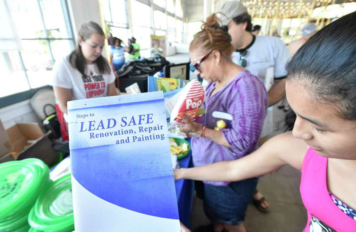 New Haven, Connecticut - Sunday, June 9, 2019: The New Haven Health Department's 19th Annual Lead Education Picnic Sunday at the Lighthouse Point Park Carousel Building in New Haven. The interactive Lead Education Picnic aims to educate local families about childhood lead poisoning prevention through discussion, educational giveaways, food and entertainment. The event included free lunch and snacks, face-painting, balloon artistry, potting plants, carousel rides, and dyeing t-shirts.