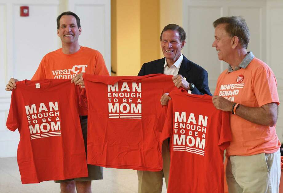 Above, Rep. Jim Himes, left, Sen. Richard Blumenthal, center, and Gov. Ned Lamont hold up shirts from Moms Demand Action at the Concert to Honor Victims and Survivors of Gun Violence St. Catherine of Siena Church in Riverside Sunday. Presented by Moms Demand Action, the concert featured music by the Hilltop Music Collective. Speakers included Tara Donnelly Gottlieb, at right, who lost her parents in a shooting in 2005. Photo: Tyler Sizemore / Hearst Connecticut Media / Greenwich Time