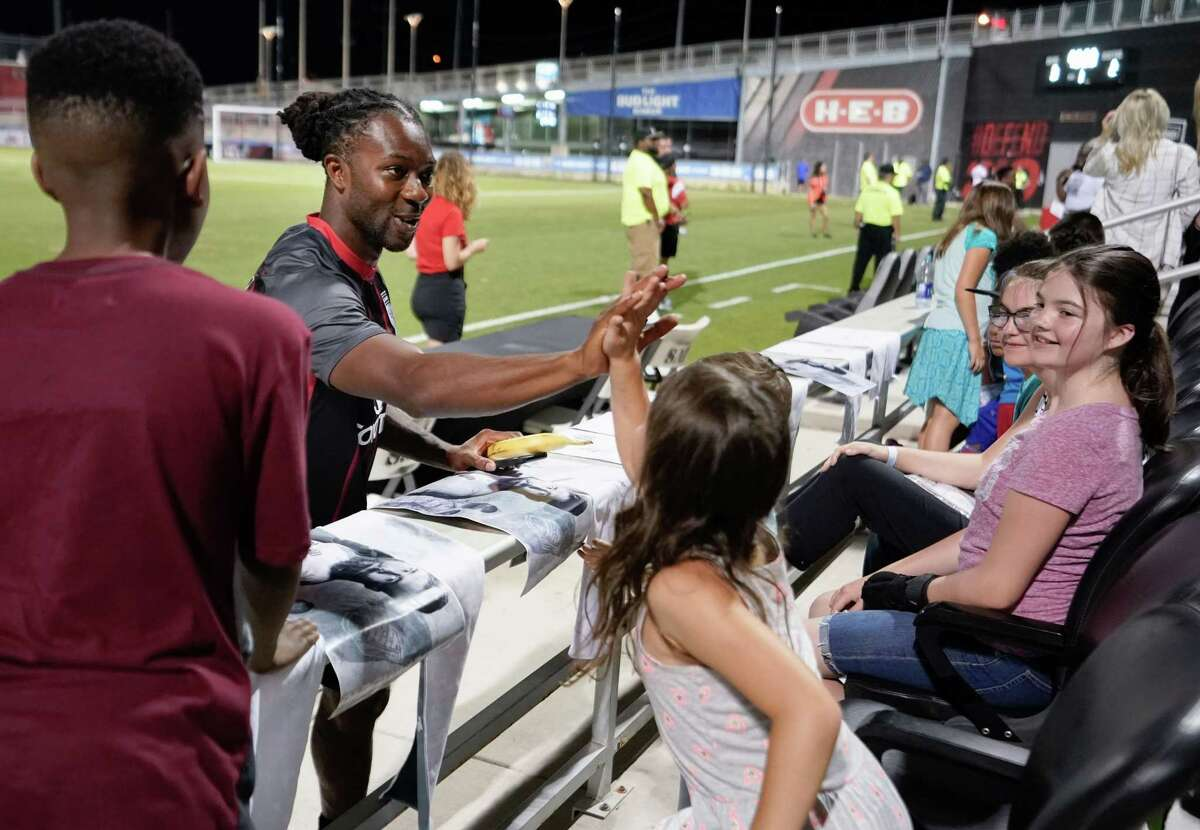 San Antonio FC midfielder Michael Lahoud interacts with a fan during military appreciation night.