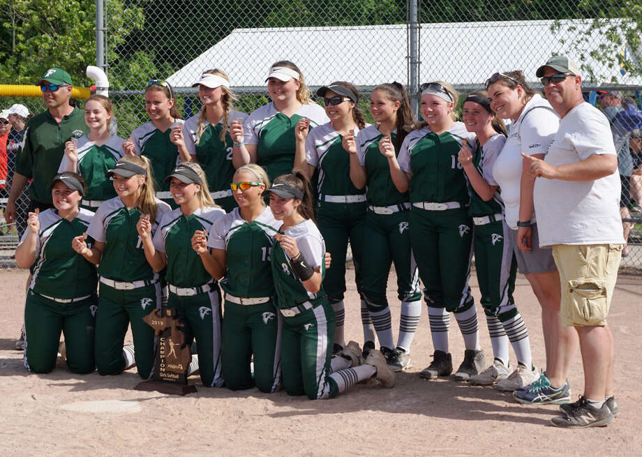 Members of the Freeland softball team and coaches pose for a photo with the regional championship trophy. Photo: Submitted Photo