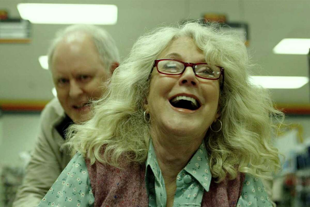 John Lithgow, left, with Blythe Danner, plays a man obsessed with the end of the world in the rom-com