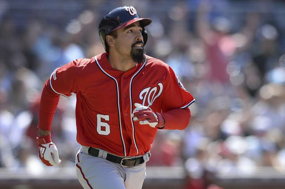 Anthony Rendon watches the ball as he completes Washington's string of four consecutive home runs. Photo: Orlando Ramirez / Associated Press