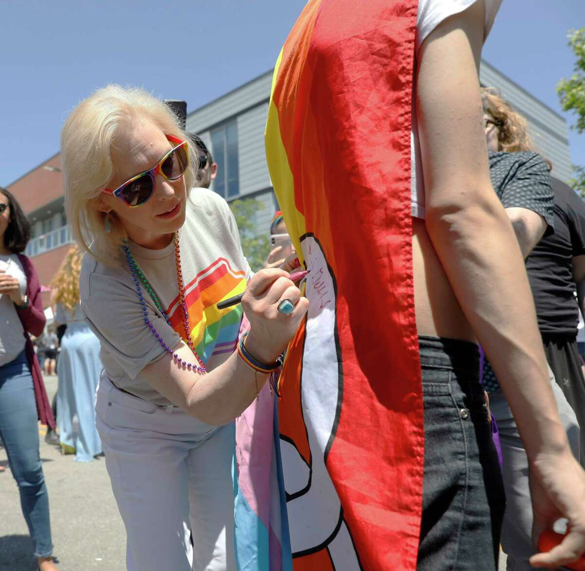 Democratic presidential candidate Kirsten Gillibrand signs an autograph during the Capital City Pride Fest, Saturday, June 8, 2019, in Des Moines, Iowa. (AP Photo/Charlie Neibergall)