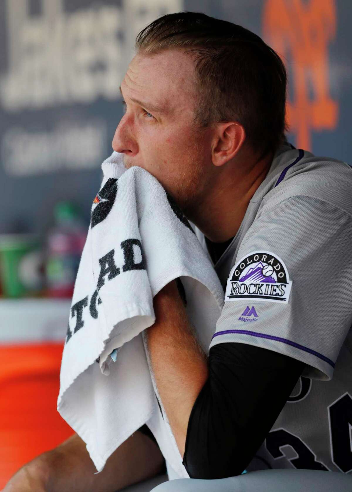 Colorado Rockies starting pitcher Jeff Hoffman sits in the dugout between innings during a baseball game against the New York Mets, Sunday, June 9, 2019, in New York. (AP Photo/Kathy Willens)