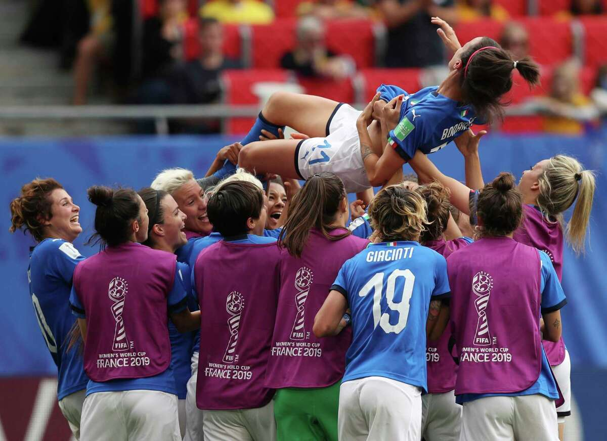 Italy's Barbara Bonansea is tossed in the air by teammates after their victory in the Women's World Cup Group C soccer match between Australia and Italy at the Stade du Hainaut in Valenciennes, Sunday, June 9, 2019. (AP Photo/Francisco Seco)